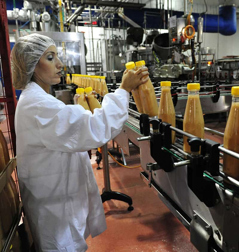 Production line worker in food factory